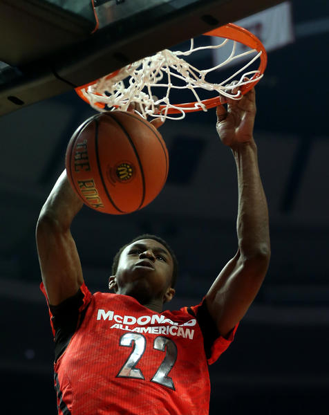 Andrew Wiggins dunks in the first half during hte McDonald's All-American game at the United Center.
