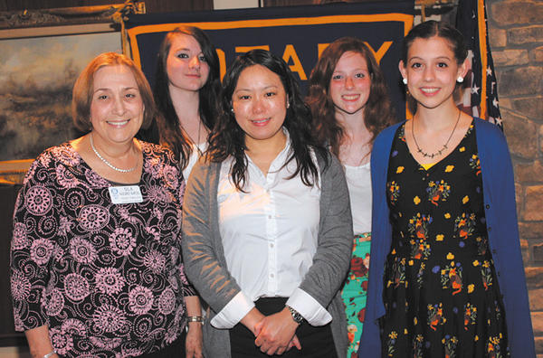 Ayako Shiga, who teaches Japanese at Boonsboro High School, spoke to the Rotary Club of Long Meadows on April 22. From left, Rotary member Sila Alegret-Bartel, Allyson Sikes, Shiga, Randi Stavrou and Samantha Juedemann.