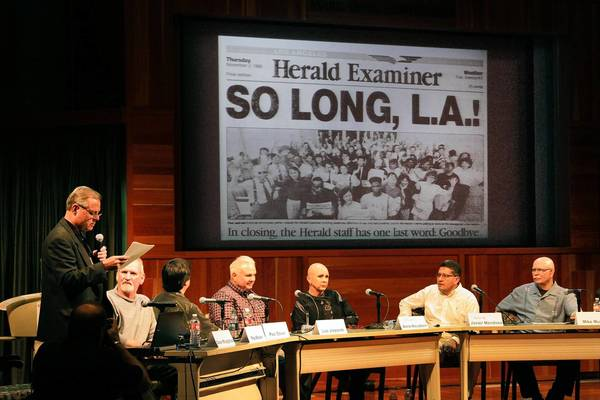 Dean Musgrove, left, former Herald Examiner photographer and current photo editor at the Daily News, moderates panel at the L.A. Central Library, which has put 90,000 images from the defunct Herald Examiner's archives online.