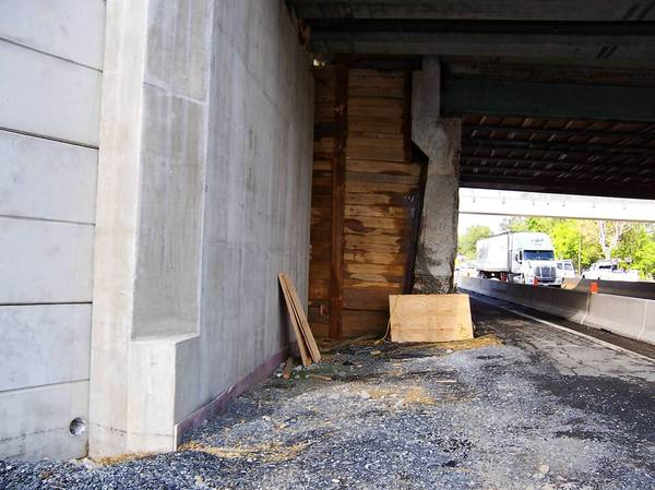 The north abutment (left) of the new MacArthur Road Bridge over Route 22 is set 14 feet farther back from that of the old bridge (center, at plywood sheet), providing space for an extra westbound lane when construction is completed.