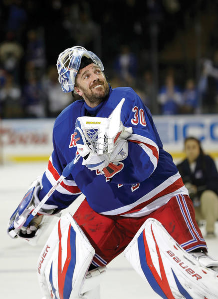 New York Rangers goalie Henrik Lundqvist (30) launches his stick into the stands after shutting out Washington 1-0 on Sunday, forcing a decisive game in the seven-game series.