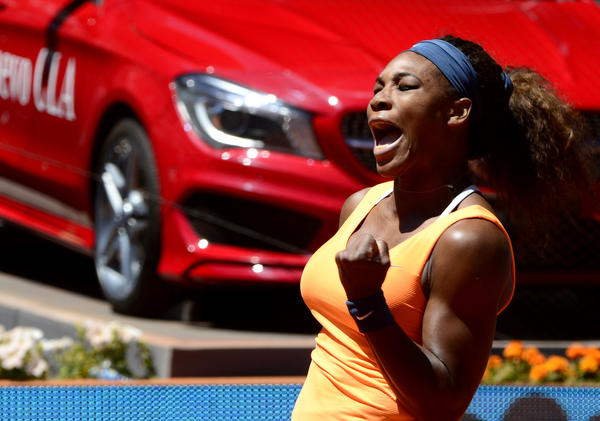 Serena Williams celebrates a point against Maria Sharapova during their women's singles final match at the Madrid Masters.