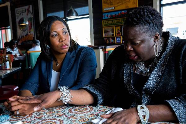 Principal Rhonda Larkin, right, of Alex Haley Elementary Academy and Taquia Hylton of West Pullman Elementary talk during lunch at local restaurant last week. West Pullman Elementary is closing, and students will be moving to Alex Haley Elementary.