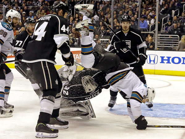 Sharks forward goes flying into Kings' goaltender Jonathan Quick