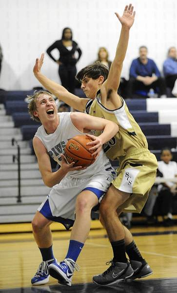 Pius X's Caleb Knudsen (left) is closely guarded during a game last year against Salem Christian. Knudsen had transferred from Pleasant Valley.
