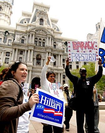 Clinton and Obama supporters rally outside Philadelphia's City Hall.