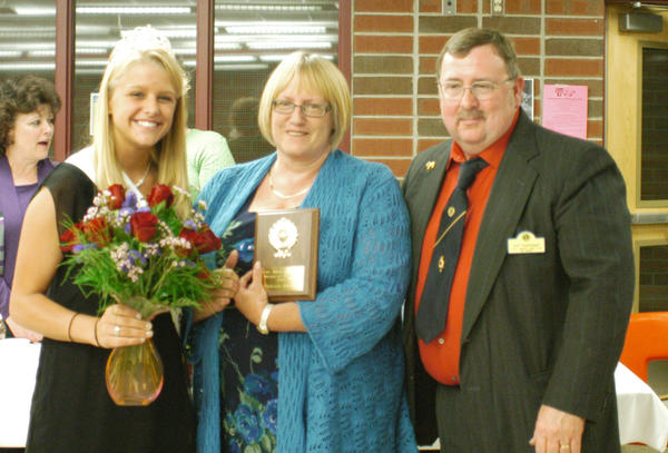 Phyllis Priest (center) was honored as the mother of the year during the East Jordan Lions Club mother and daughter banquet Saturday. Presenting the award were Miss East Jordan, Rachel Bernier, and Lions Club president Jeff Argetsinger.