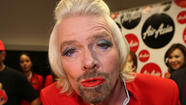 Sir Richard Branson loses a bet, becomes flight attendant