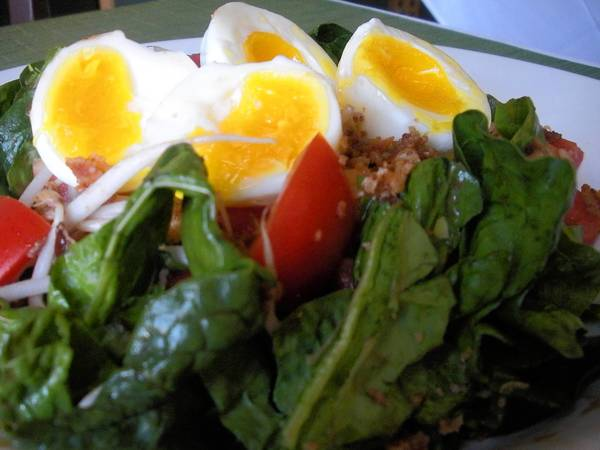 Fresh spinach acts as the base for this egg and greens salad.