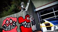 Neighbors of singer Chris Brown claim artwork outside his Hollywood Hills home is scaring local kids and ruining the aesthetic of the area.
