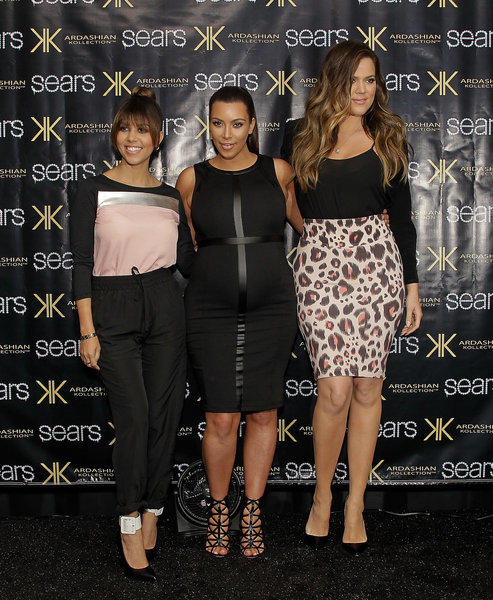 Kourtney Kardashian, left, Kim Kardashian and Khloe Kardashian Odom greet fans at a Sears in Houston.