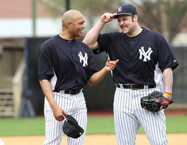 New York Yankees relief pitcher Joba Chamberlain (62) and relief pitcher Mariano Rivera (42) talk during spring training at George M. Steinbrenner Field.