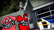 The monsters painted on Chris Brown's house might scare some children in his Hollywood Hills neighborhood -- but not all of them.