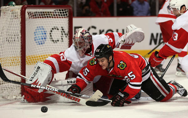 The Blackhawks' Andrew Shaw (65) is unable to score on Detroit Red Wings goalie Jimmy Howard (35)during a game last month.