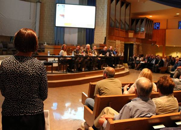 Concerned Lisle residents asked village officials for answers about flood recovery Thursday evening.