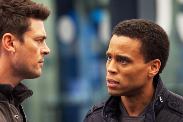 "Karl Urban, left, as John Kennex and Michael Ealy as Dorian partner to fight crime in the year 2048 in the new FOX drama, ""Almost Human,"" premiering this fall on FOX."