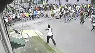 Security camera video released today by New Orleans police appears to capture the moment when a gunman opened fire on a crowd at a Mother's Day parade. Nineteen people were wounded, including two children.