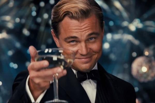 "Leonardo DiCaprio raises a glass in Baz Luhrmann's ""The Great Gatsby."""