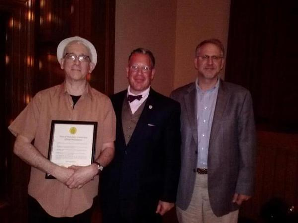 Dan Thompson (left) received his official proclamation from Mayor Leo Diana and Arts Commission Chairman Bob Eckert.