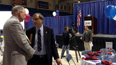 Glenn Wilson, president of AmeriServ Financial in Johnstown, talks with Somerset County Commissioner John Vatavuk at the Johnstown Area Regional Industries annual luncheon at the War Memorial Arena in Johnstown. In the background, JARI President Linda Thomson talks with a member of the media at the event to announce the organizations 2012 accomplishments.