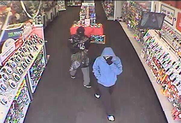A surveillance image of the suspects in a robbery of a Radio Shack in Orange Saturday.