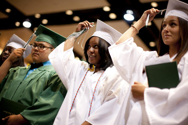 In this June 2012 file photo, Washington High School graduates move their tassels at the end of commencement exercises. Graduation rates released by the state Monday show Washington with the highest graduation rate  88.8 percent  among South Bend public schools. (South Bend Tribune/JAMES BROSHER)