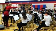 Concert band members from Emerson Middle School in Niles got some tips from an Australian composer whose piece they later performed in concert.