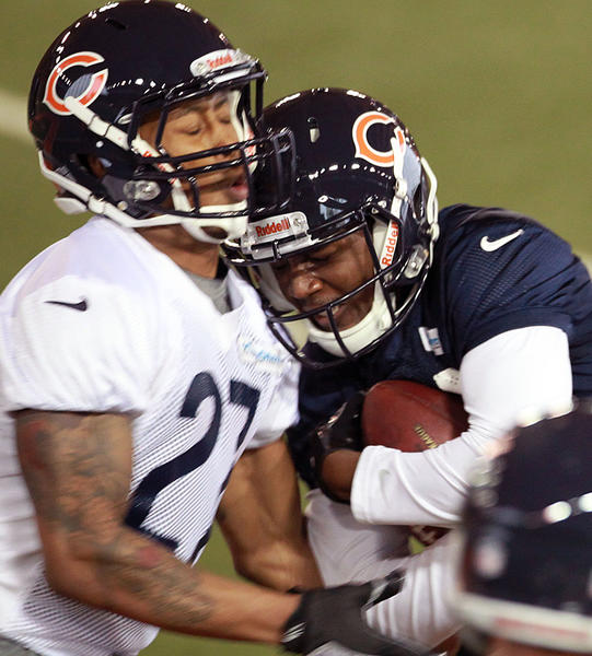 Cornerback Maurice Jones (left) collides with receiver Terrence Toliver during the Bears' rookie minicamp.