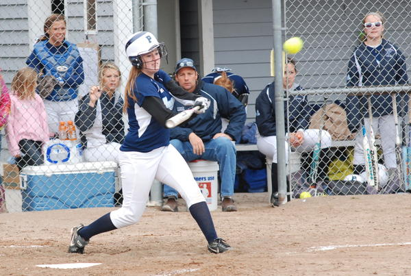 Petoskey's Breanna Merriam connects for a triple during the Northmen's game against Warren Cousino at the Jennifer Kullik Memorial Invitational Saturday at Bayfront Park's Ed White Field. The Northmen defeated the Patriots, 6-5.