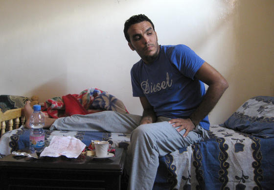 Abdelaziz Majbiri, 29, rests  at his home in Benghazi, Libya. Majbiri was employed by the British private security firm Blue Mountain to help guard the U.S. consulate and was shot in the leg during the Sept. 11 attack.