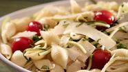 Pasta salad with zucchini, basil, tomatoes and cheese