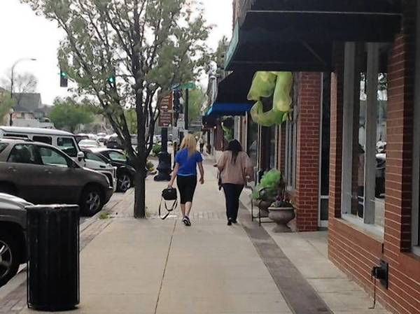 Shoppers along State Street in downtown Geneva. Officials are considering a business district.