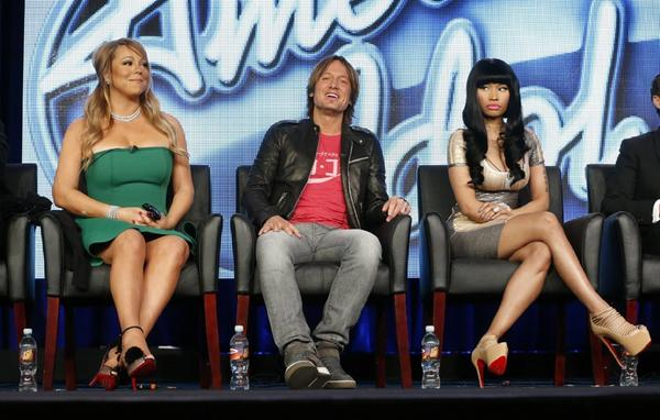 """American Idol"" views can weigh in on certain elements of the show using Twitter hashtags. ""Idol"" judges Mariah Carey, left, Keith Urban and Nicki Minaj."