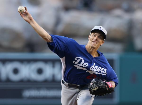 Dodgers starter Zack Greinke delivers a pitch during an exhibition game against the Angels.