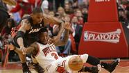 Heat center Chris Bosh scrambles Monday for a loose ball against Bulls guard Nate Robinson. ( Mike DiNovo, USA Today Sports)