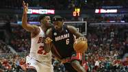 Miami Heat's James goes to the basket against Chicago Bulls' Butler during the first half of Game 4 in their NBA Eastern Conference semi-final game in Chicago, Illinois