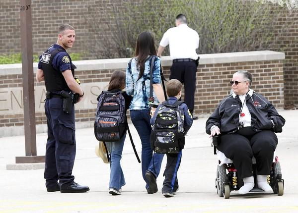 Police are stationed at the main entrance of Oakwood Elementary School in Lemont on May 6 after a bomb threat was found on an exterior wall. The school was searched and no bomb was found.