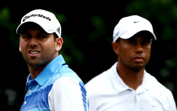 Tiger Woods and Sergio Garcia stand on the 11th tee during round three of The Players Championship.