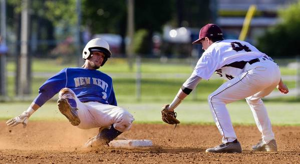 New Kent's Nick Valentino slides safely past Poquoson's Greg Chauvin into second base during the eighth inning of Monday's game.
