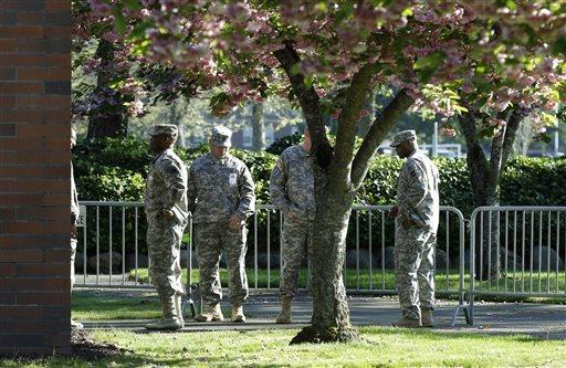Soldiers assisting with communications and security tasks stand outside the building at Joint Base Lewis-McChord, Wash., during the court-martial for Army Sgt. John Russell.