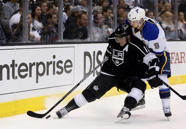 Kings' Anze Kopitar battles for position against St. Louis Blues' Jaden Schwartz during Game Six of the first-round series.