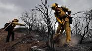 WASHINGTON — The drought that caused record wildfires in California and other Western states last year is expected to persist through the summer, but fewer firefighters will battle this year's blazes in other regions because of federal budget cuts, top federal officials said Monday.