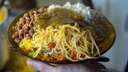 NEW YORK (Reuters Health) - Despite public health progress in cutting calories, as well as salt and fat from fast foods and supermarket products, neighborhood restaurants are still packing big helpings of each into their meals, a trio of studies suggests.