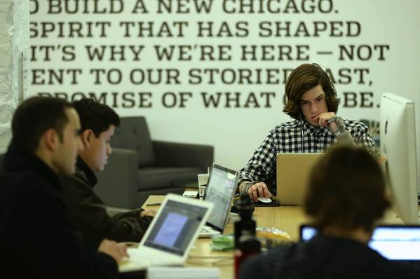 Dylan Opet, of Yella Rewards, works in the shared space at 1871, a tech incubator in Chicago. Illinois' tech sector added 3,361 jobs in 2012, with the total workforce numbering 209,776 people, a report says.