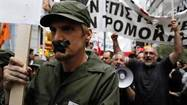 ATHENS (Reuters) - Greek public sector workers walked off the job on Tuesday to protest against a government decision to ban a strike by high-school teachers, shutting down several schools and reducing staff at hospitals to a minimum.
