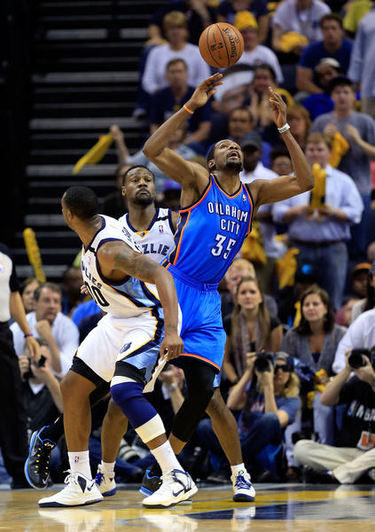 Kevin Durant #35 of the Oklahoma City Thunder loses control of the ball as Darrell Arthur #00 and Tony Allen #9 of the Memphis Grizzlies defend during Game Four of the Western Conference Semifinals of the 2013 NBA Playoffs at FedExForum on May 13, 2013 in Memphis, Tennessee.