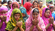 NEW DELHI, India -- Thousands gathered Tuesday in the rubble of the collapsed Rana Plaza garment factory complex in Bangladesh to pray for the 1,127 victims who died in the ruins of the world's worst apparel industry disaster.