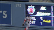 Nationals' Bryce Harper runs into wall