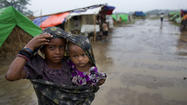 NEW DELHI – A boat carrying approximately 100 Rohingya Muslims capsized late Monday off the coast of Myanmar with many of its occupants feared dead, UN officials said, as the region braced for a cyclone expected to slam low-lying areas inhabited by the embattled minority.