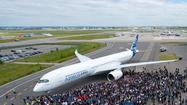 With the Paris Air Show just one month away, European plane-maker Airbus got one step closer to the first flight of its new A350 XWB passenger jet, rolling out one of the aircraft from its paint shop in Toulouse, France.